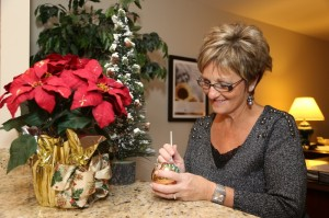 Donna Brandt puts finishing touches on a holiday ornament.